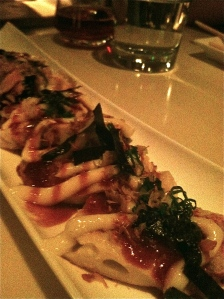 Okonomiyaki Rice Pancake with Pork Belly, Scallop, and Shrimp with Sweet Garlic Soy Sauce, Mayonnaise, Seaweed, and Bonito Flakes.