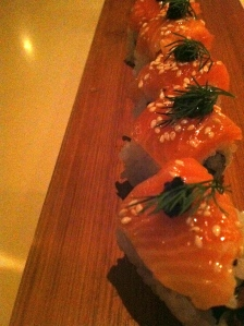 Smoked Salmon Roll with Asparagus Tempura, Black Sesame Paste, and Fresh Dill.