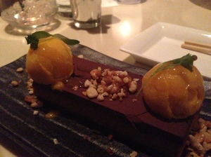 Chocolate Curry and Peanut Butter Bar with Puffed Rice, Mango Sorbet, and Passion Fruit Caramel.